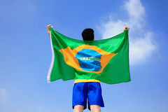 Excited man holding a brazil flag Royalty Free Stock Photo