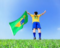 Excited man holding a brazil flag Stock Images
