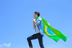 Excited man holding brazil flag Stock Photo