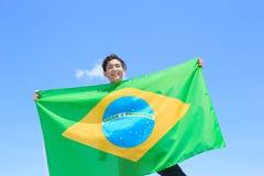 Excited man holding brazil flag Stock Image