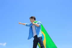 Excited man holding brazil flag Royalty Free Stock Images