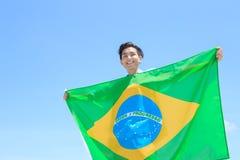 Excited man holding brazil flag Stock Images