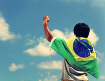 Excited man holding a brazil flag. Facing the sky royalty free stock images