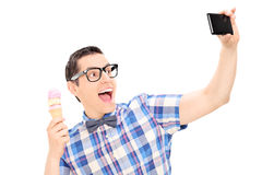Excited man holding ice cream and taking selfie. Isolated on white background Stock Image
