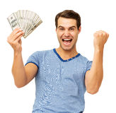 Excited Man Holding Us Currency. Portrait of excited young man clenching fist while holding US currency over white background. Horizontal shot Royalty Free Stock Image