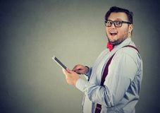Excited man impressed with new tablet royalty free stock photos