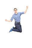 Excited man jumping with joy. Isolated on white background Royalty Free Stock Image