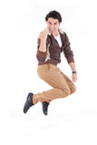 Excited man jumping out of joy achieving success Royalty Free Stock Photography