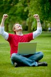 Excited man with laptop Royalty Free Stock Photos