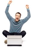Excited man with laptop. Young man over white background Royalty Free Stock Image