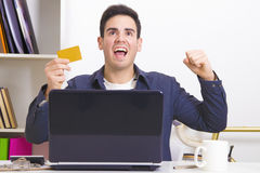Excited man on laptop Stock Images