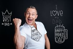 Excited man looking happy while celebrating Fathers Day stock images