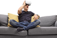Excited man looking in VR goggles Stock Images