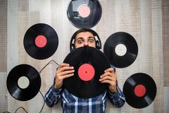 Man lying on the floor with  headphones among  vinyl records Stock Images