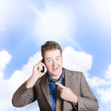 Excited man on mobile phone. Yes! Got the job Royalty Free Stock Photo