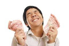 Excited Man With Money. A very excited man holding handfulls of Canadian Money Royalty Free Stock Photo