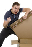 Excited man opening a parcel Royalty Free Stock Photo