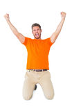 Excited man in orange cheering Royalty Free Stock Photo