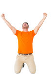 Excited man in orange cheering Royalty Free Stock Image