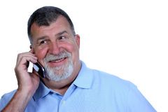 Excited Man on Phone. A smiling and excited man talks on the phone Stock Photo