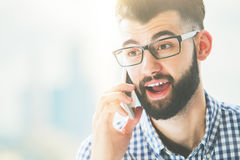 Excited man on phone. Excited young man on phone. Close up portrait Royalty Free Stock Images