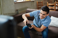 Excited Man Playing Video Games Royalty Free Stock Photo