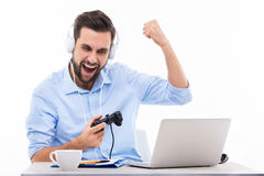 Excited man playing video games Stock Photography