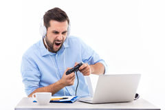 Excited man playing video games Stock Images