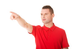 Excited man pointing Royalty Free Stock Photography