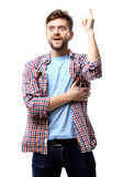 Excited man pointing a great idea - isolated over white background Stock Photo
