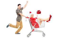 Excited man pushing a cart and woman Royalty Free Stock Photography