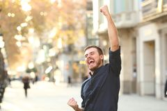 Free Excited Man Raising Arms Celebrating Sucess Stock Photography - 136584612