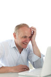 Excited man reading his laptop screen Royalty Free Stock Photography