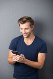 Excited man reading an sms on his mobile Royalty Free Stock Photography