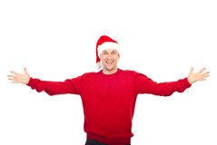 Excited man with Santa hat welcoming. Excited man wearing red pullover and Santa hat standing with arms open isolated on white background Stock Photos