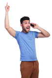 Excited man screaming while talking on the phone. Super excited man screaming of joy while talking on the phone Royalty Free Stock Photography