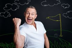 Excited man showing his happiness while playing golf and winning royalty free stock photos