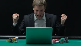 Excited man sincerely rejoicing at winning big sum of money in online casino