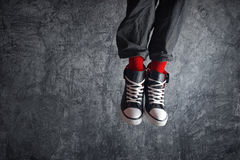 Excited man in sneakers jumping Royalty Free Stock Photography