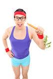 Excited man in sportswear eating a carrot Stock Image