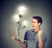 Excited man succeed in online world stock images