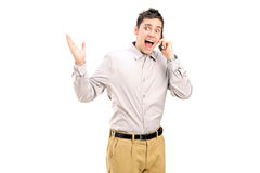 Excited man talking on the phone Stock Photo