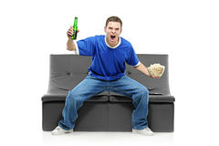 Excited man watching sport Royalty Free Stock Photography