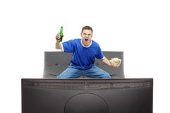 Excited man watching sport on a TV Stock Photo