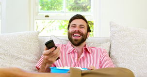 Excited man watching tv stock video