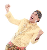 Excited man wearing traditional of java celebrating success Royalty Free Stock Photos