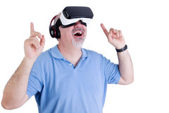 Excited man wearing virtual reality glasses Stock Images