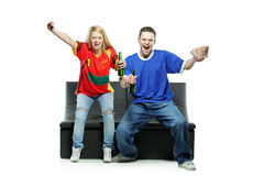 Excited man and woman watching sport Royalty Free Stock Photos