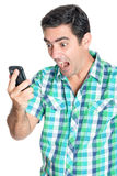 Excited man yelling at his mobile phone Stock Images