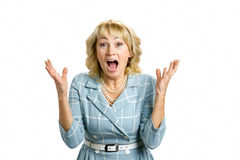 Excited mature lady, white background. Stock Images